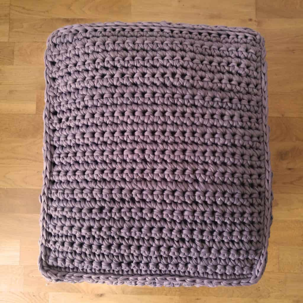 Top view of finished T-Shirt yarn crocheted pouf/footstool