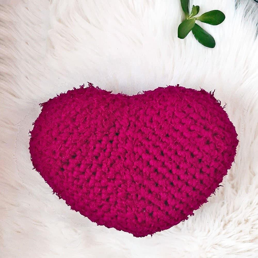 Crochet Heart Pillow on rug