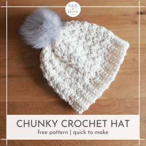 Chunky Crochet Hat with pompom on table