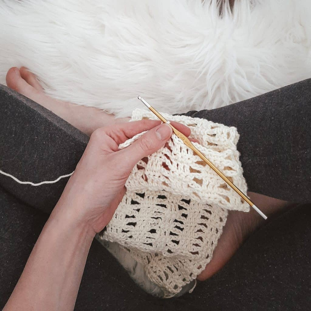 crocheting with legs crossed